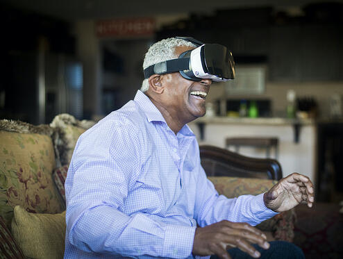 old man wearing VR headset