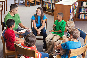 Middle school students sitting in a circle