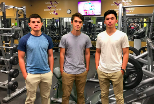 Three male students at Vista Ridge High School posing in weight room