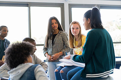Students talking together in a group