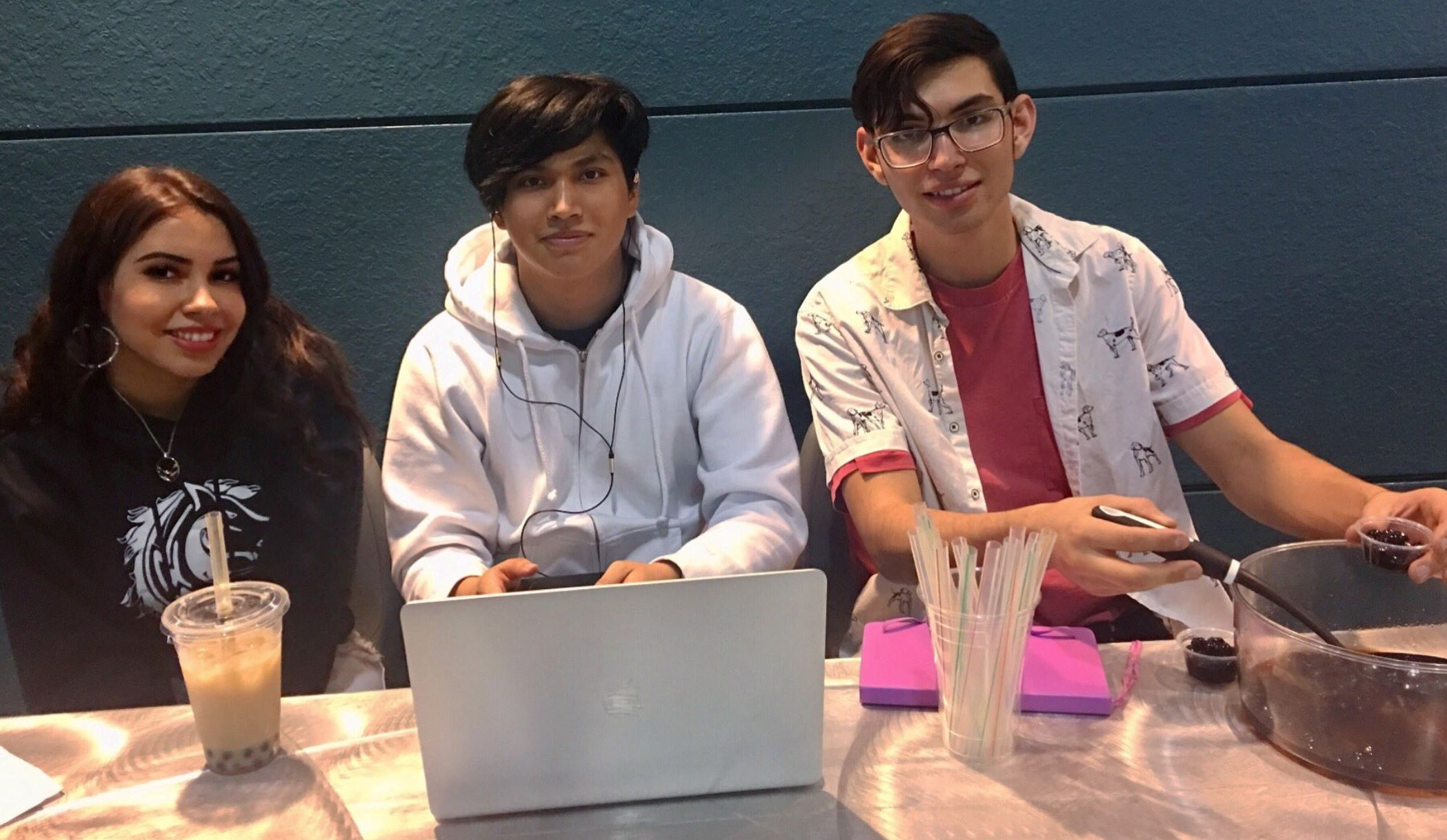 student entrepreneurs at laptop